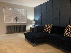 dark blue walls with raw metal radiator