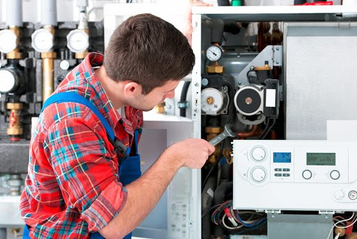 boiler being repaired by a a trained tradesperson